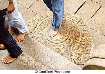 """""""moon"""" stone at the entrance to the buddhist temple - TEMPLE..."""