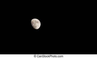 Moon time lapse moving across night sky. 4K