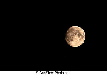 Moon turning red in the dark sky