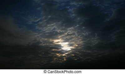 Moonlight in the clouds - Timelapse of setting full moon and...