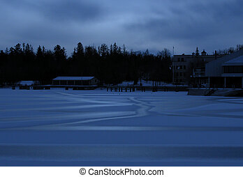 ice on an urban lake by moonlight