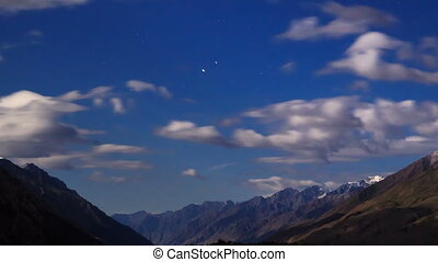 Moonlit night in the mountains. Time Lapse
