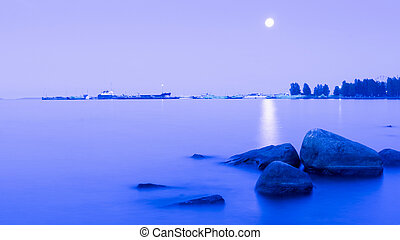 Moonlit path on the lake surface