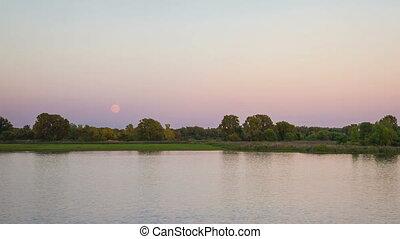 Moonrise Over Detroit River - A super moon rise at dusk over...