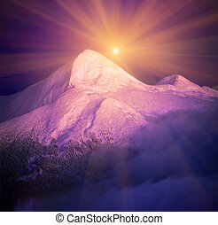 Moonrise among alpine peaks, unforgettable beauty of the spectacle, worth dangerous night-climbing in winter. Goverla-highest point of Ukraine