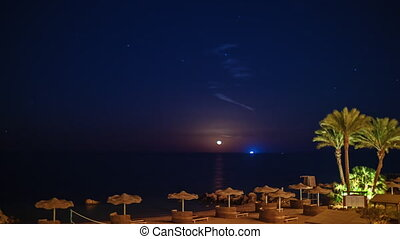 Moonrise over the tropical coast, meteorite falls