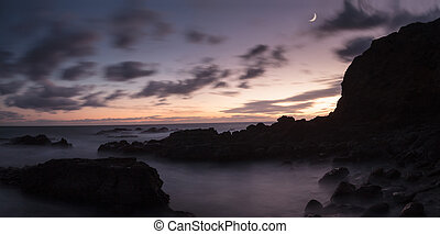 Moonset and sunset at Crescent Bay