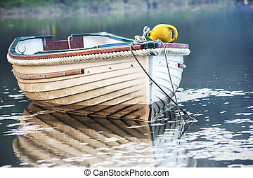 A boat moored on the Lerryn River in Cornwall