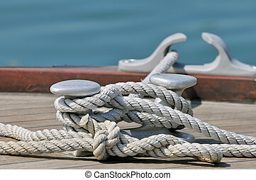 Moored boat - Close-up of rope tied up on a bitt