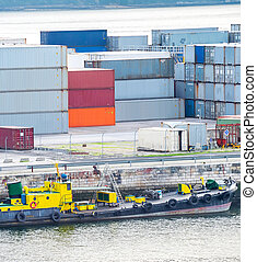 Moored boats and freight containers - Boats moored by pier...