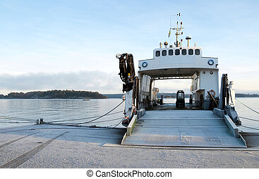 Moored ferryboat - Small ferryboat moored at quay on a calm...