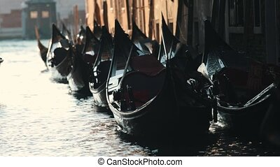 Moored gondolas floating in the gateway. Italy. Close up