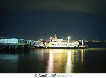 Moored ship at the pier at night.