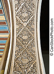 A detail of a Moorish style stucco of a arch in Marrakesh