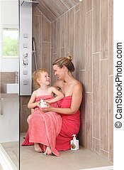 Moother and Daughter in  wheelchair accessible walk in Shower