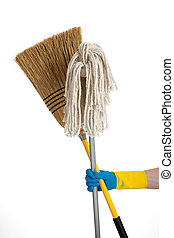 Mop and broom being held by a rubber gloved hand
