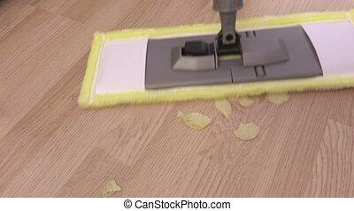 Mop on floor near food waste