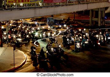 Mopeds in Queue