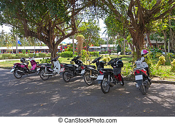 mopeds on  parking