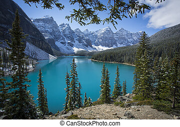 Beautiful Moraine Lake in Banff National Park with light dusting of snow. Valley of the Ten Peaks, Canadian Rocky Mountains, Alberta, Canada