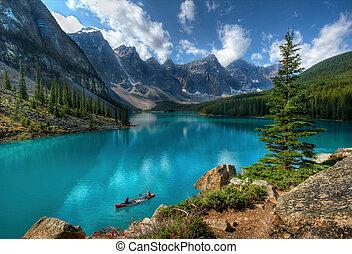 Boaters on Moraine Lake, Banff National Park, Alberta, Canada.