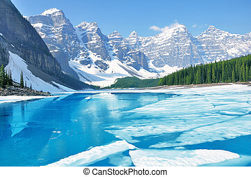 Moraine lake under the ice at morning spring time. Banff National park. Canada.
