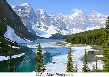 Moraine lake under the ice at spring morning.