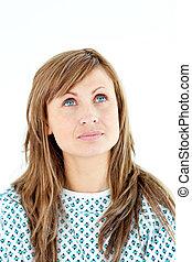 Morbid female patient looking upwards wearing patient gown...