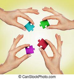 morceaux puzzle, main humaine