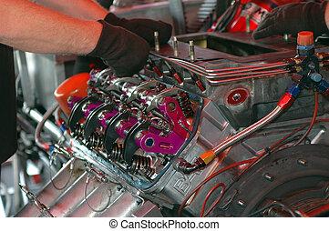 More Power - Engineer adjusting powerful race car engine.
