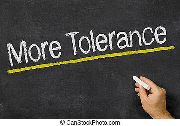 More Tolerance written on a blackboard