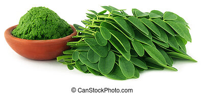 Moringa leaves with paste on a brown bowl over white...