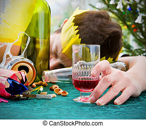 morning after christmas day, woman asleep on table with...