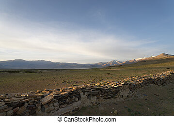 Morning at Himalayan lake near buddhist wall