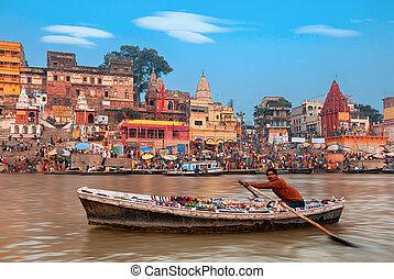 Morning at holy ghats of Varanasi, India - A view of holy...