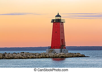 Morning at Manistique Lighthouse - The sky glows with color ...