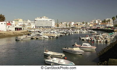 Morning at the sea dock with fishing boats in city of Faro. Portugal