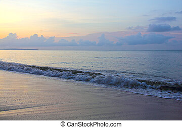 Morning beach - Beautiful surf on beach at sunrise in...