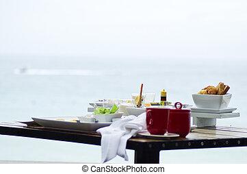 Morning breakfast near sea