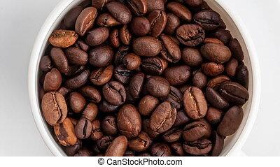 Morning coffee. Coffee magic. Roasted coffee beans.