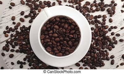 Morning coffee. Coffee magic. Roasted coffee beans turn into...