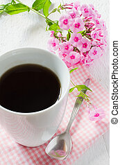 Morning coffee or cup of tea with pink flowers. - Morning...
