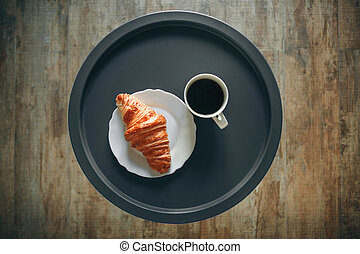 Morning coffee with a croissant
