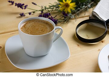 Morning cup of coffee on wooden table