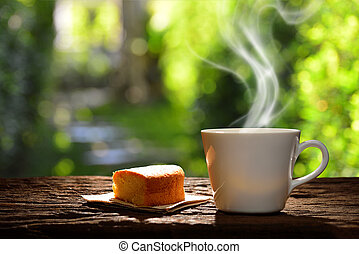 Morning cup of coffee with cake in the garden