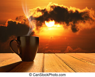 Morning cup of coffee with sunrise background
