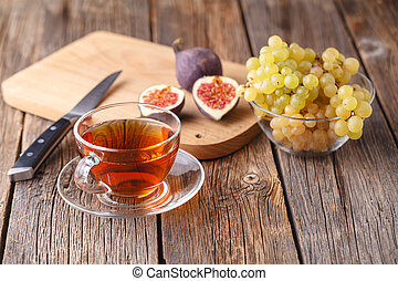 morning cup of tea with fruit, healthy breakfast