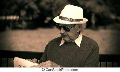 Morning Edition - Black and white shot of senior man reading...