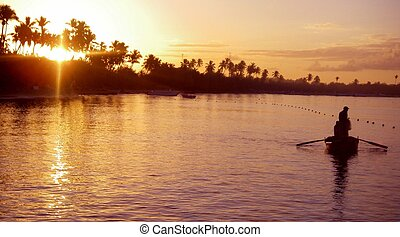 Morning Fisherman - A man in a small fishing boat at sunrise
