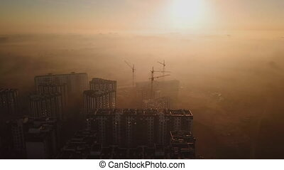 morning flight at dawn over the construction of houses, ...